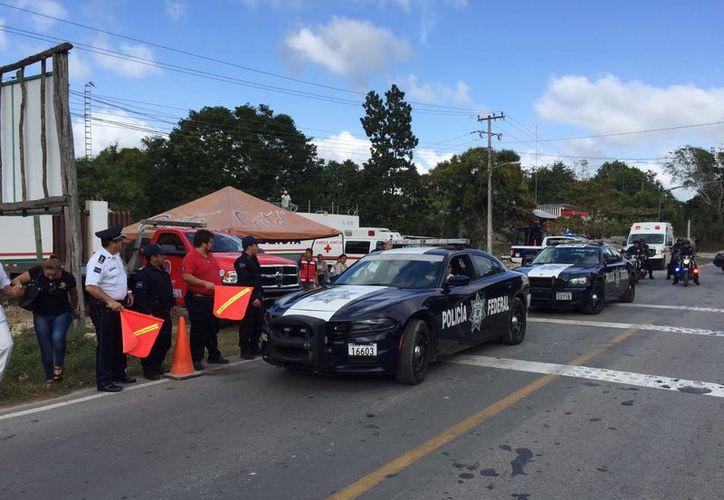 En el operativo participa la Policía Federal, Policía Municipal Preventiva, Cruz Roja, entre otras dependencias. (Jesús Caamal/SIPSE)