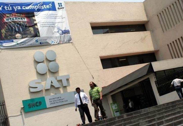 Aseguran que el SAT no está facultado para divulgar los nombres y el RFC de los contribuyentes incumplidos. (Archivo/SIPSE)
