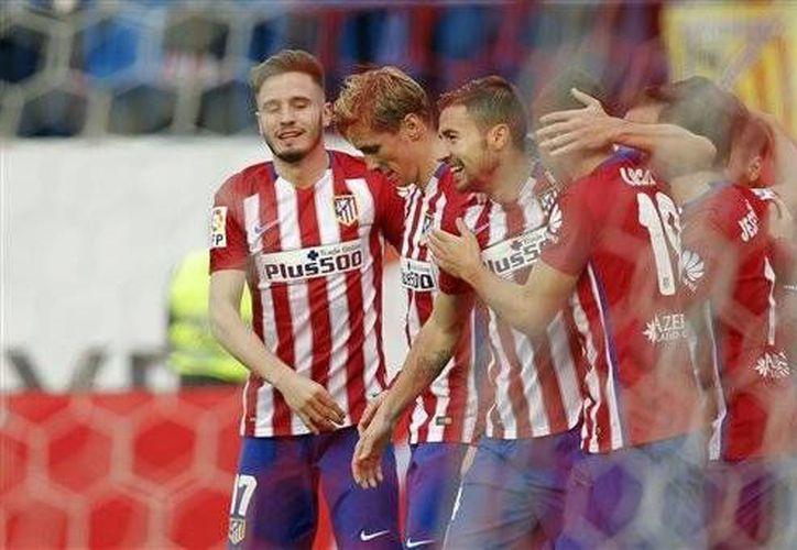 Fernando Torres fue autor del tercer gol del Atleti. El delantero español llegó a 100 goles en su carrera con la playera de los 'Colchoneros'. (AP)