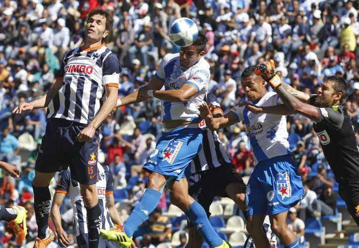 Monterrey y Puebla tuvieron este domingo su segundo empate cada uno en el Clausura 2014. (Notimex)