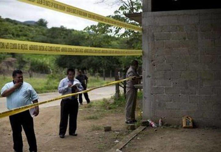 La CNDH había recomendado al Estado Mexicano reparar los daños a los familiares de las víctimas del caso Tlatlaya. La imagen corresponde al peritaje realizado en la zona donde ocurrió el enfrentamiento el 30 de junio de 2014. (Archivo/SIPSE)