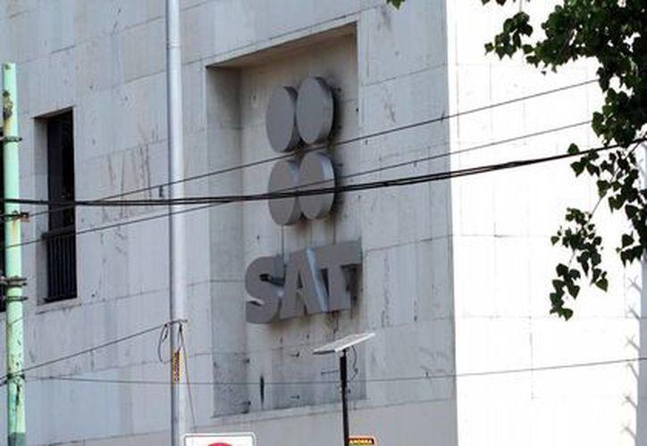 Hasta el 14 de abril, en el SAT, se atendieron 911 mil 428 solicitudes de devolución por un monto de seis mil 741 millones de pesos con devoluciones promedio de siete mil 396.9 pesos. (Archivo/Notimex)