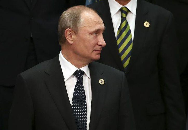 El presidente de Rusia, Vladimir Putin, durante la foto de la cumbre del G-20 en Brisbane, Australia. (Agencias)