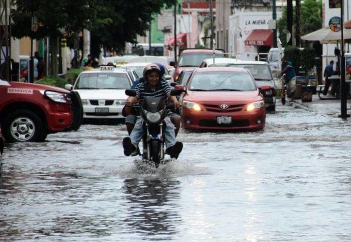 Pronostica el SMN que este jueves lloverá fuerte en algunos estados del país, como Yucatán, Quintana Roo, Puebla y Campeche. (Foto de archivo de SIPSE)