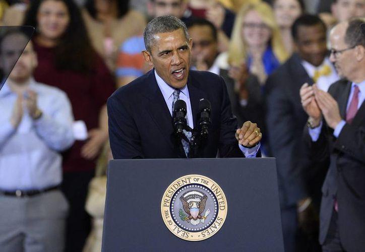 Obama indicó que la mayoría de los estadounidenses aprueban el aumento de salario mínimo. (EFE)