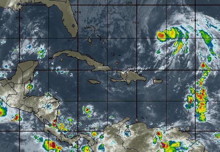 Se espera cielo parcialmente nublado, con 50 por ciento de probabilidad de lluvias en Cancún y Chetumal. (Intellicast)