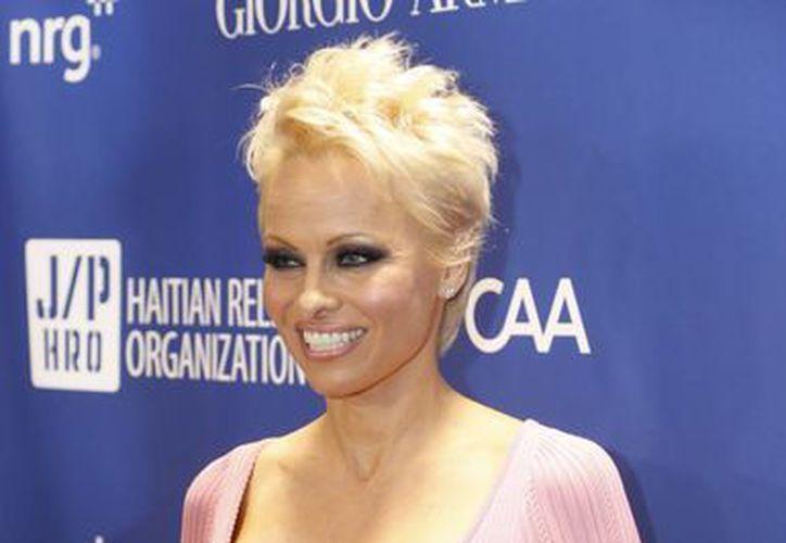 Foto del 11 de enero del 2014 en donde Pamela Anderson llegó a la 3a gala anual Sean Penn & Amigos Ayudan a Haití, en el Hotel Montage en Beverly Hills, California. (Agencias)