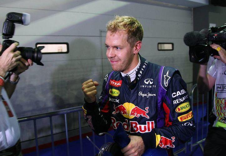 Vettel concluyó la calificación sentado en su cochera. (Foto: Agencias)