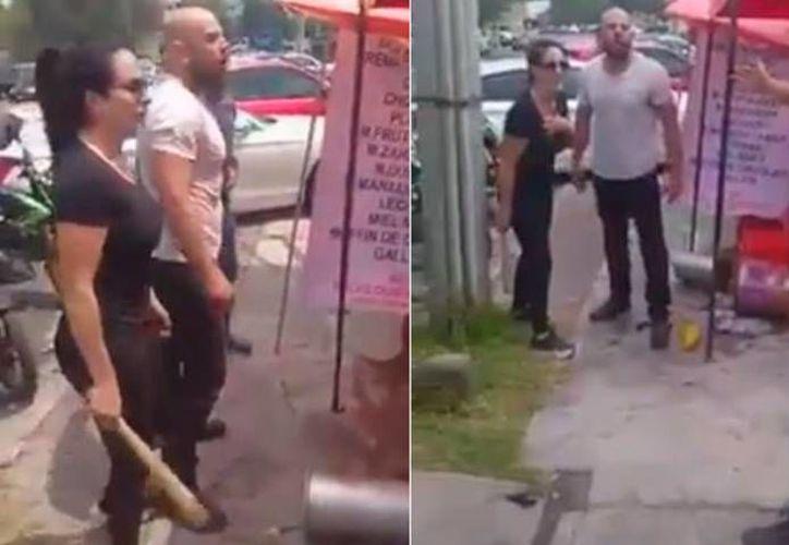Un hombre y una mujer sometieron a un vendedor y le destruyeron su puesto de nieves el sábado pasado en Naucalpan; el video se viralizó. (elsoldemexico.com.mx)