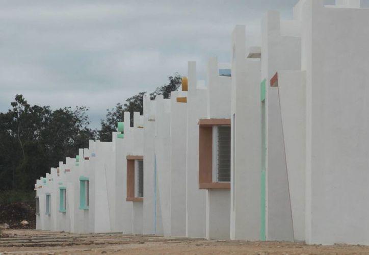 Según cifras proporcionadas por la Conavi, la banca privada va ganando terreno en créditos hipotecarios.  (Benjamín Pat/SIPSE)