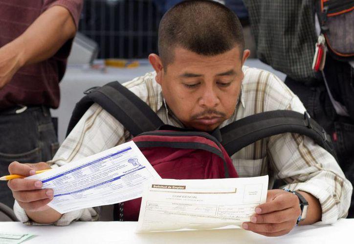 En el tercer trimestre de 2014, la tasa de desempleo disminuyó 0.05 puntos porcentuales. (Archivo/Notimex)