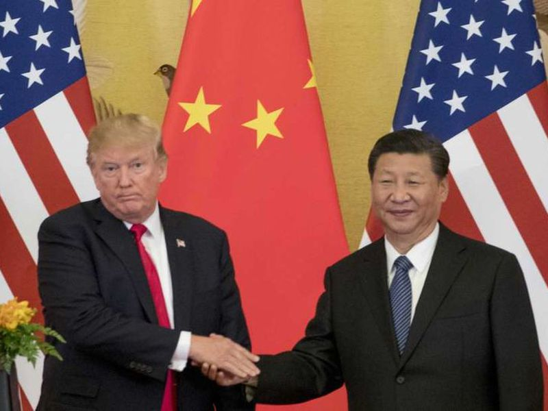 President Donald Trump and Chinese President Xi Jinping shake hands during a joint statement to members of the media Great Hall of the People in Beijing, China.