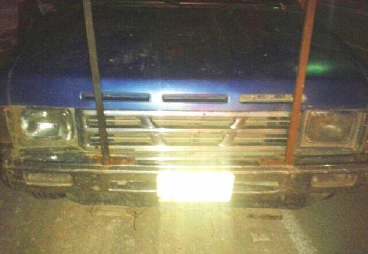La camioneta de los comerciantes resulto con cuatro impactos de bala. (Javier Ortiz/SIPSE)
