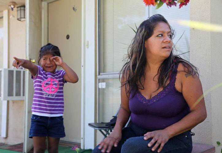 Cristina Melendez y su hija Lupita. (Agencias)