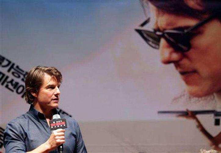 Tom Cruise, protagonista de la cinta 'Mission Impossible-Rouge Nation', película que lidera la taquilla durante esta semana, en Estado Unidos. (AP)