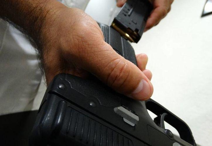 El registro de armas, largas y cortas, ante la Secretaría de la Defensa Nacional aumentó 397 por ciento entre 2011 y 2014. (Cortesía)
