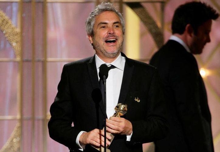 """Alfonso Cuarón se llevó el premio al mejor director por """"Gravity"""". (Agencias)"""