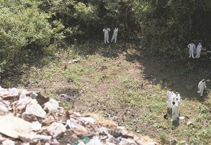 El basurero de Cocula fue revisado por autoridades en búsqueda de los cuerpos de los normalistas de Ayotzinapa. (Archivo/AP)