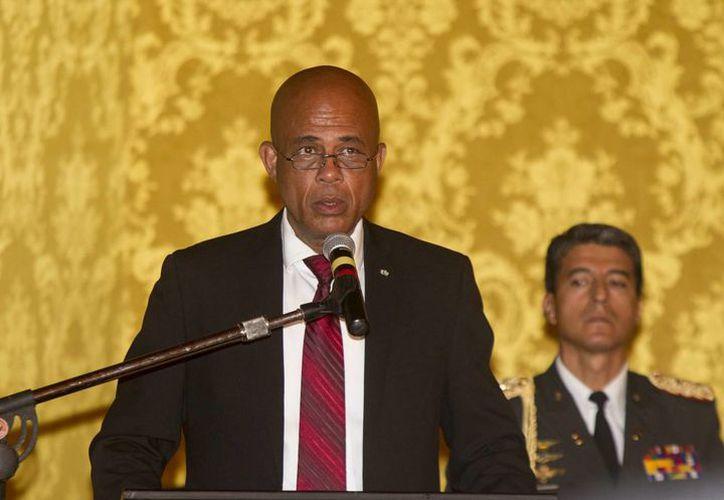 Durante las protestas los haitianos lanzaron insultos contra el presidente Michel Martelly. (Archivo/EFE)