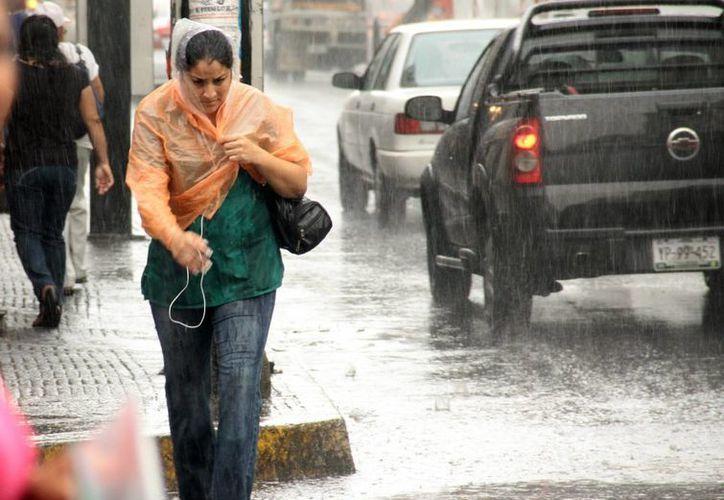 Las lluvias aliviaron ayer por la tarde a los meridanos que habían resistido una temperatura de  38.7 grados Celsius, aunque en la noche volvió a llover. (SIPSE)