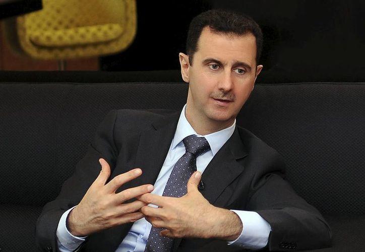 Fotografía facilitada por la Agencia de noticias siria SANA del presidente de Siria, Bachar al Asad, durante una entrevista. (Archivo/EFE)