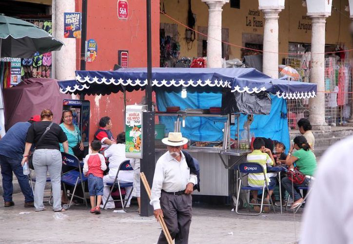 En el centro de Mérida aún impera la formalidad. (Milenio Novedades)