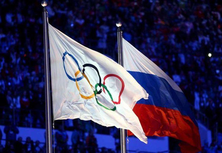 La delegación de Rusia podrá participar en Río 2016, aunque no podrá contar con plantel completo. (AP)