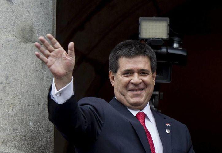El presidente de Paraguay, Horacio Cartes, asegura tener la conciencia tranquila en cuanto al problema de contrabando de tabaco que hay hacía México. (Archivo/EFE)
