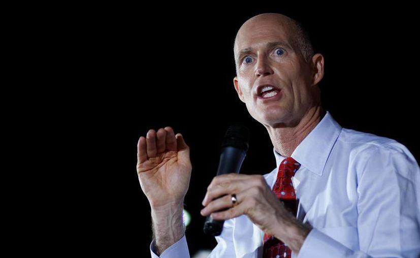 En la imagen, el gobernador de Florida, Rick Scott, quien intervino para aclarar el asunto. (EFE/Archivo)