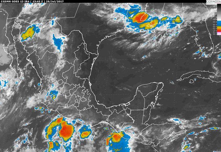 Prevén para Quintana Roo un ambiente caluroso y viento del este de 15 a 30 kilómetros por hora. (Imagen de satélite).