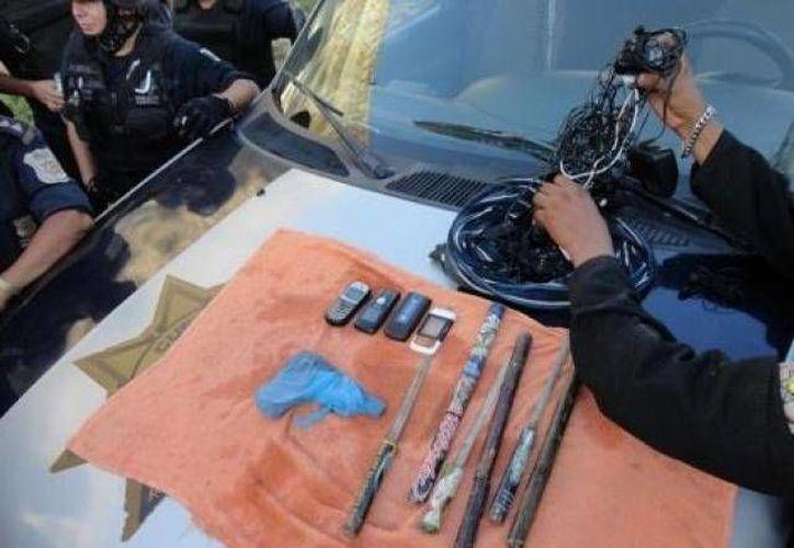 Más de 100 elementos de la policía acreditable y estatal participaron en el cateo en el penal de Acapulco durante tres horas. (Agencias/Foto de contexto)