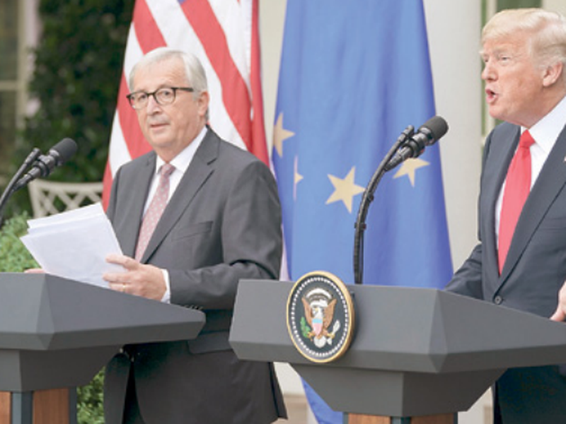 President Donald Trump and European Commission president Jean-Claude Juncker speak in the Rose Garden of the White House, in Washington. (AP)
