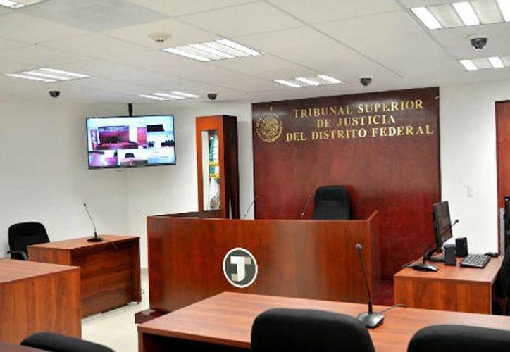 Una de las salas donde se celebró ayer una de las audiencias del nuevo modelo de justicia. (Milenio)