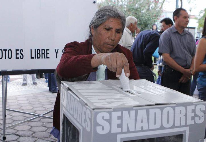 Para las elecciones del próximo 7 de junio de 2015 se capacitará a un millón 266 mil 208 funcionarios de casilla. (Archivo/Notimex)