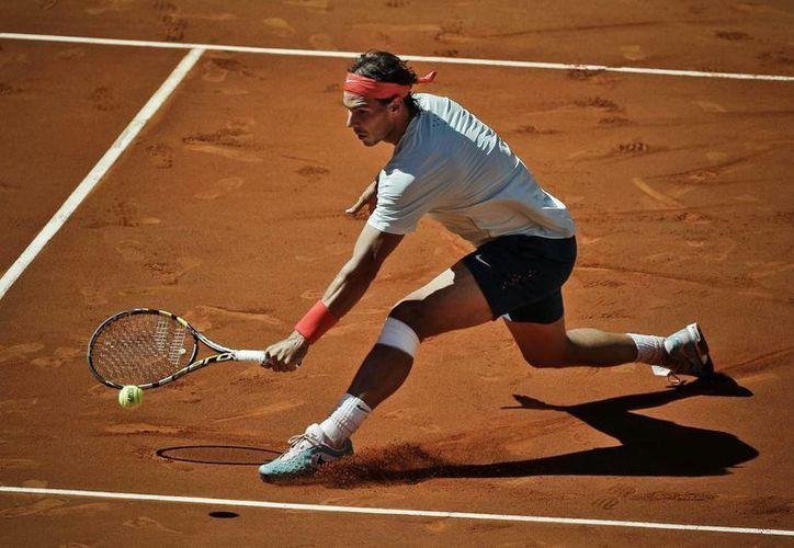 El tenista español Rafael Nadal en las instalaciones de la Caja Mágica, en Madrid. (EFE)