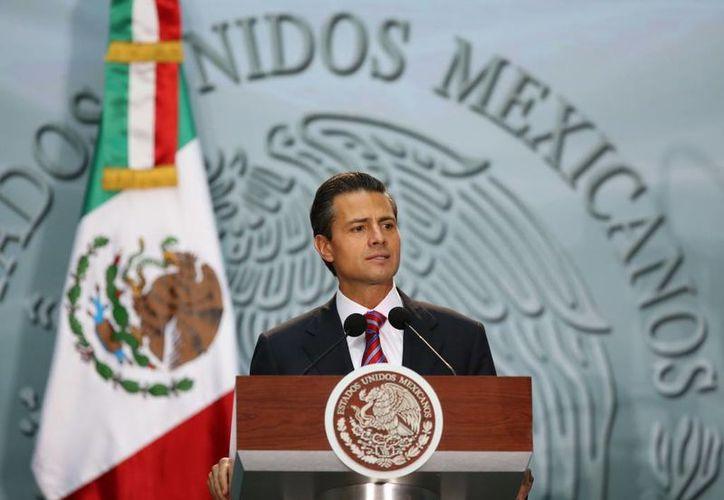 El presidente Enrique Peña Nieto en la entrega del Premio Nacional de Ciencias y Artes, este miércoles en Palacio Nacional. (presidencia.gob.mx)