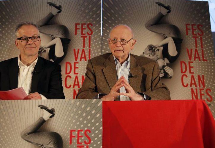 El presidente del festival de Cannes, Gilles Jacob (d), con el director artístico Thierry Fremaux durante una conferencia. (Agencias)