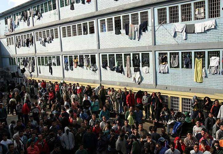 Autoridades colombianas suponen que la extrema violencia en la cárcel La Modelo fue por ajustes de cuentas de los grupos paramilitares de extrema derecha. (Foto: www.excelsior.com)