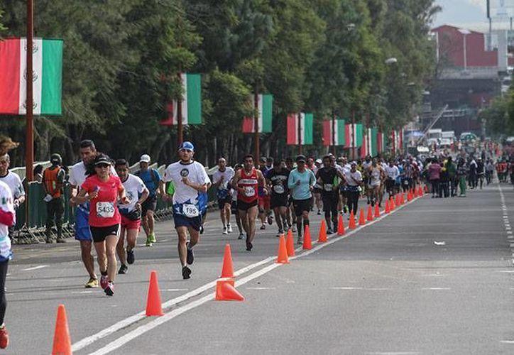 La carrera contará con un total de tres mil 524 elementos de seguridad y cooperarán dos mil 397 personas para brindar la mejor atención médica a los competidores.(Foto tomada de Milenio Digital)