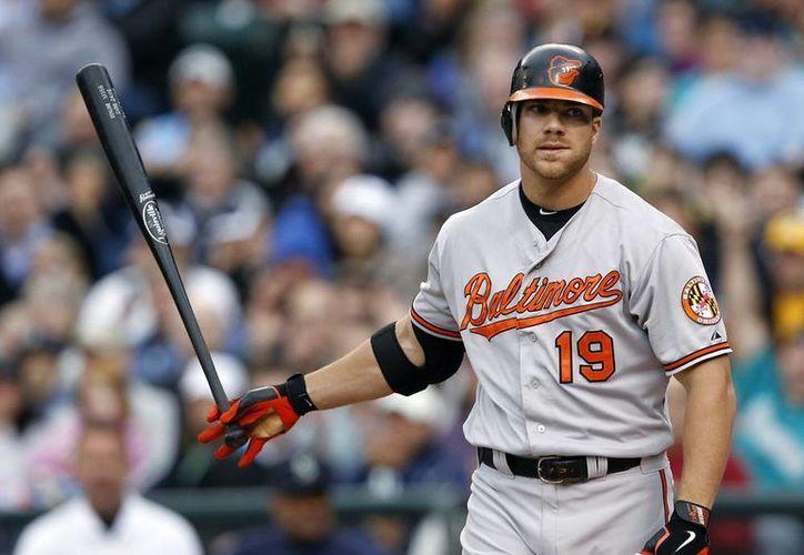Baltimore no contará con Chris Davis, el rey de jonrones de 2013, al menos hasta la Serie de Campeonato de la Liga Americana. (AP)