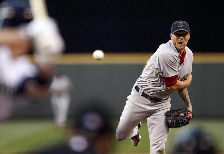 Jake Peavy ganó la Serie Mundial con Boston en 2013 y en julio de este año fue canjeado a Gigantes. (gammonsdaily.com/Foto de archivo)