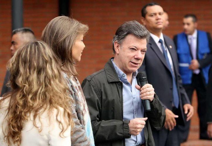 Juan Manuel Santos anunció que aumentará la fuerza con 200 policías. (Archivo/Notimex)