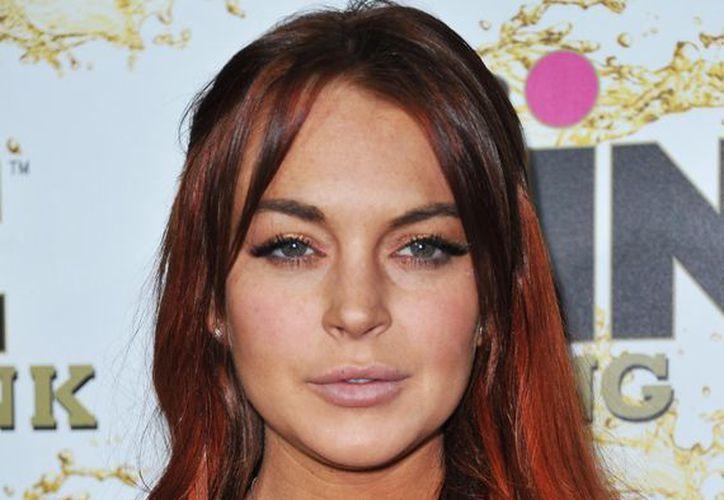 Lindsay Lohan  debía comparecer ante la corte por un delito menor de agresión por su pelea que tuvo en un club nocturno de Chelsea. (Agencias)