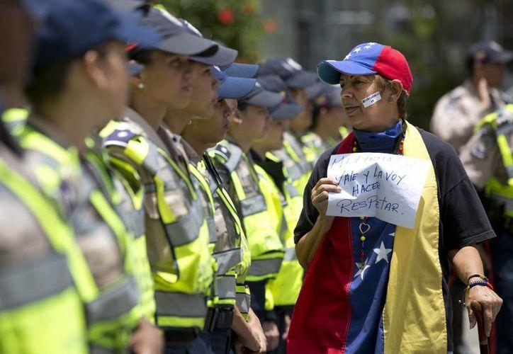 En Caracas y otras ciudades venezolanas se registraron intensas movilizaciones para exigir el referéndum revocatorio contra Nicolás Maduro. (AP)