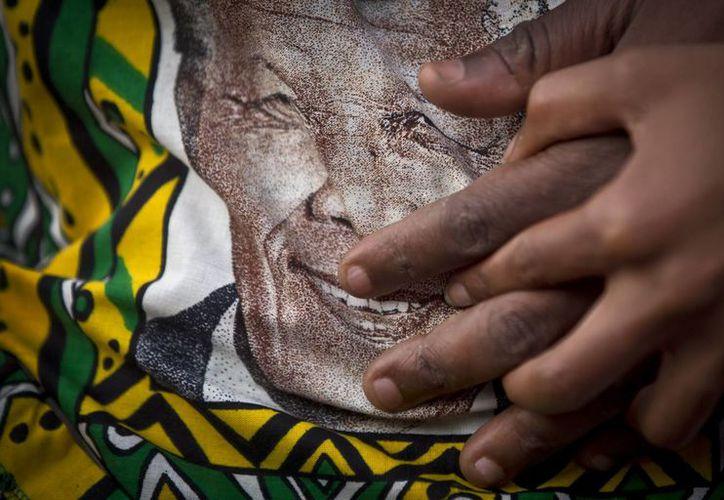 Mandela murió ayer a los 95 años en su domicilio de Johannesburgo. (Agencias)