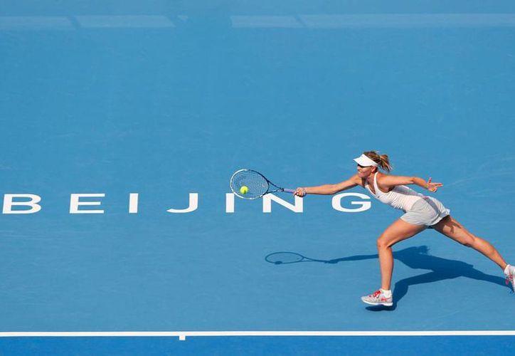 La tenista Maria Sharapova, sembrada número 4 del Abierto de China, pasó a segunda ronda. (AP)