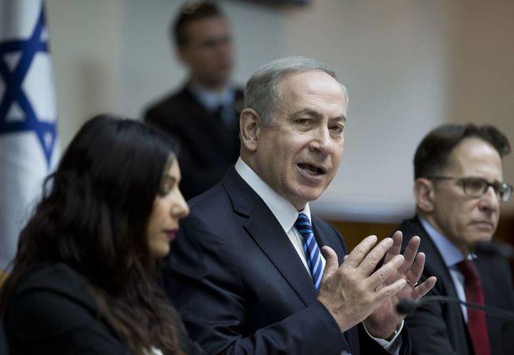 El primer ministro de Israel, Benjamin Netanyahu, se dijo deseoso de comenzar a trabajar con 'su amigo' Donald Trump. (AP/Abir Sultan)