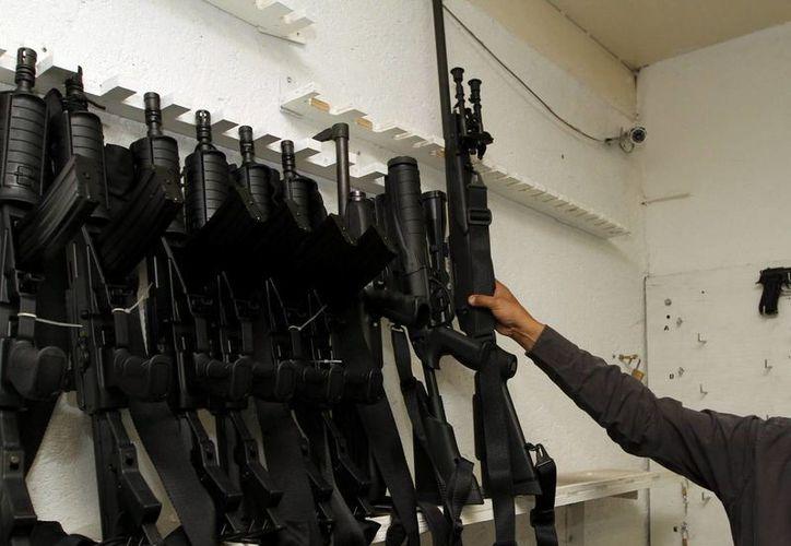 De ser aprobados en el Senado, los cambios a la Ley General de Armas permitirán que extranjeros usen armas durante el desempeño de sus labores en México. (Imagen referencial/Archivo/Notimex)