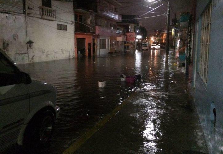 Las recientes lluvias han sido inclementes con varios estados del país, entre ellos Veracruz. (Foto de archivo de Notimex)