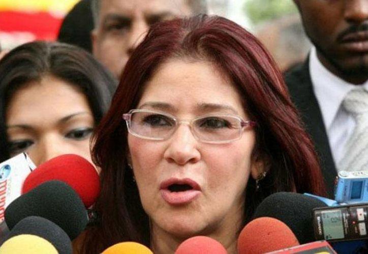 A Cilia Flores se le caracteriza por mantener una presencia discreta ante su esposo  Nicolás Maduro. (urgente24.com)